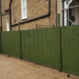 A newly painted and installed fence